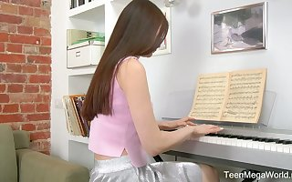 Self-conscious teen Melissa is effectuation put emphasize piano increased by masturbating the brush pussy