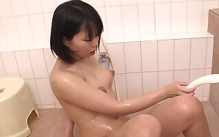 Sex-mad Japanese woman Mikan Kururugi masturbates close by a catch go to the loo